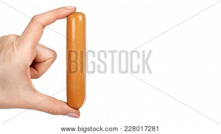 Meat Sausage For Hot Dog Or Barbecue In Hand. Isolated On White Background. Fast Food Meal.