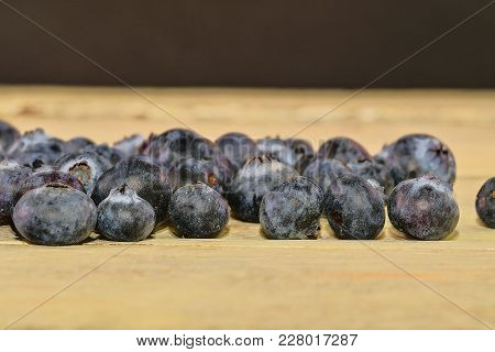 Blueberries  On White Wooden Background. Bilberries, Blueberries, Huckleberries, Whortleberries. Bla
