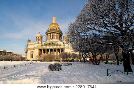 A View Of St. Isaac Cathedral In St. Petersburg On A Sunny Winter Day. In The Foreground There Is A