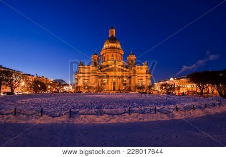 View Of Cathedral In St. Petersburg Russia On A Winter Evening. In The Foreground There Is A Snow-co