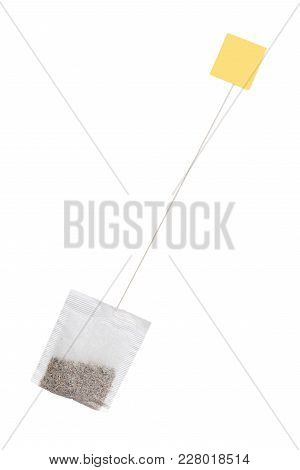 Tea In Paper Bag With Yellow Label. Isolated On White Background. Herbal Teabag.