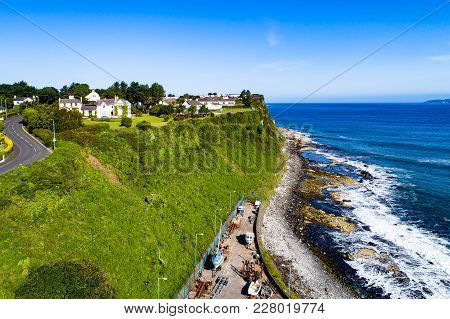 Atlantic Coast With A Steep Cliff, Marina And Causeway Coastal Road At Ballycastle, County Antrim, N
