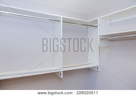 Installation Of Shelves With A Shelf Near Of Big Cabinet. Furniture Installation.