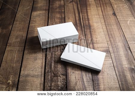 White Paper Business Cards On Wood Background. Mockup For Branding Identity. Blank Template For Your