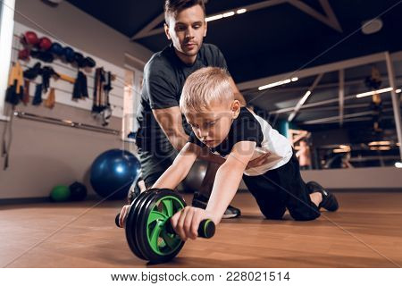 Father And Son In The Gym. Father And Son Spend Time Together And Lead A Healthy Lifestyle. A Little