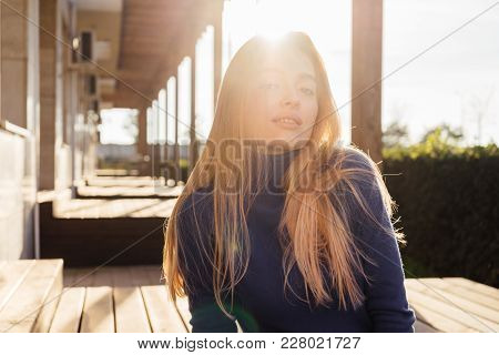 Attractive Beautiful Young Blonde Model Girl Enjoying The Sun And Posing
