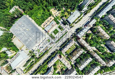 Aerial City View With Crossroads And Roads, Houses, Buildings, Parks And Parking Lots, Bridges. Heli
