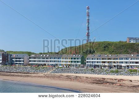 Helgoland, Germany - May 20, 2017: People Walking At Boulevard Of Helgoland With Beach And Holiday H