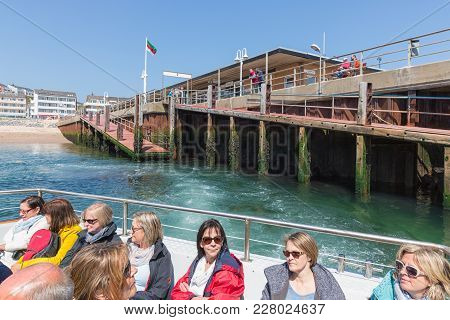 Helgoland, Germany - May 20, 2017: Women In Little Ferry Leaving Harbor Of Helgoland On Its Way To T