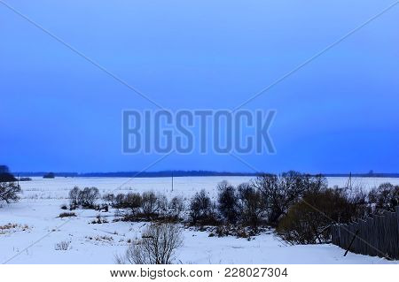 The Winter Field And Blue Sky, Evening