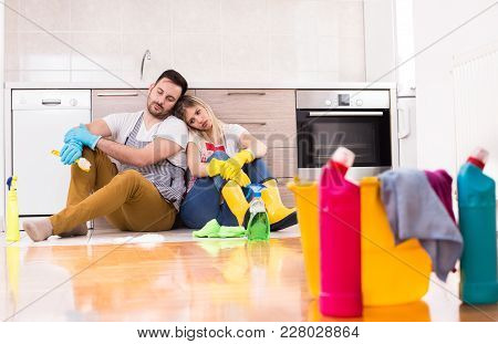 Tired Young Couple After Chores Sitting On Floor