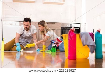 Young Couple Cleaning House Together