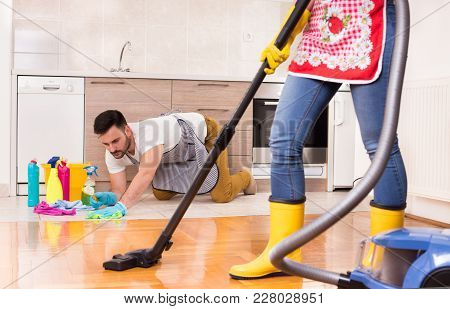 Young Couple Doing Housework Together