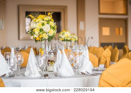 Restaurant Table Decoration Or Setting For Wedding Party. Colorful Bouquet Of Field Flowers In The G