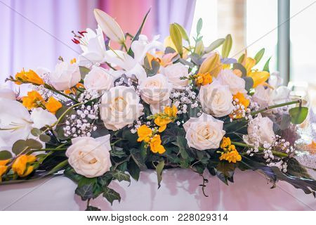 Colorful Wedding Table Flowers In White And Yellow, Close Up. Restaurant Table Decoration Or Setting