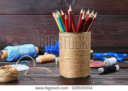Bank For Pencils With Hearts Wrapped With String On A Wooden Table. Handmade