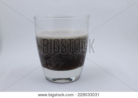 Glass Of Root Beer Isolated On A White Background