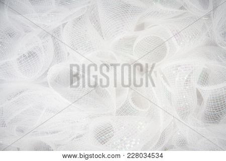 Pure White Tulle Fabric In An Intricate Frill That Can Be Used As The Background For Bridal Showers