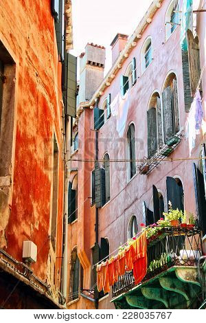 A House In Venice, Italy With The Laundry Hanging Outside To Dry.