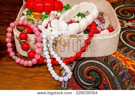 Bijouterie, Earrings, Beads And Rings In A Box