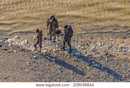 Greenwich, London, Uk - January 20, 2017: Three People Searcrhing For Treasure On The River Thames