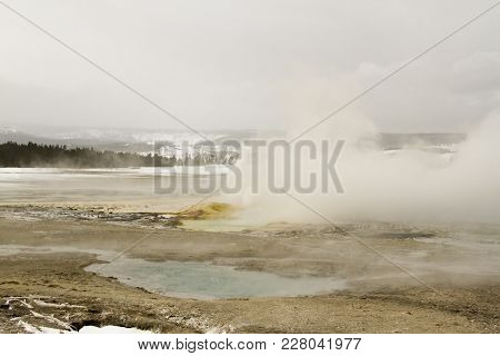 Fountain Geyser With Smaller Vents Erupting At Fountain Paint Pots In Yellowstone National Park