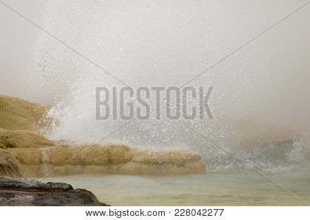 Close Up Of Geyser Erupting At Fountain Paint Pots In Yellowstone National Park