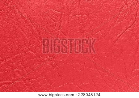 Surface Leather Substitute With Creases And Wrinkles In Red Color As Background Or Texture.