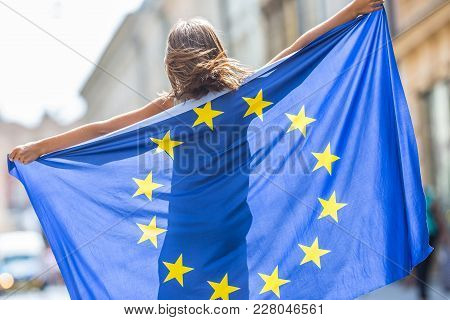 Eu Flag. Cute Happy Girl With The Flag Of The European Union. Young Teenage Girl Waving With The Eur