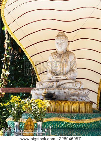 Marble Buddha Image At Local Temple In Yangon, Myanmar.