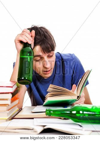 Student With A Beer Read A Book On The School Desk Isolated On The White Background