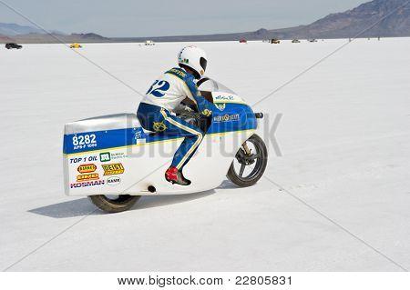 WENDOVER, UT - AUGUST 13: Jim Hoogerhyde races his 1000cc Suzuki motorcycle on the Bonneville Salt Flats during Bonneville Speed Week on August 13, 2011 near Wendover, UT.