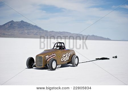 WENDOVER, UT - AUGUST 13: A 1938 Ford Roadster with its parachute deployed on the Bonneville Salt Flats during Bonneville Speed Week on August 13, 2011 near Wendover, UT.