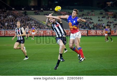 MELBOURNE - AUGUST 20 : Simon Black of Brisbane (R) and Dayne Beams of Collingwood contest a ball during Collingwood's  win over Brisbane - August 20, 2011 in Melbourne, Australia.