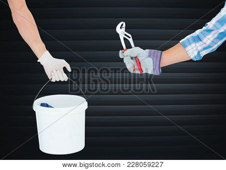Digital composite of Hand with cube and hand with other tool in front of blind