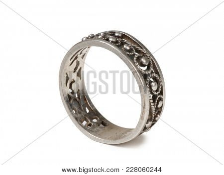 Ancient silver ring on a white background