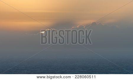 Sunrise On A Misty Morning On Omaha Beach, Normandy France