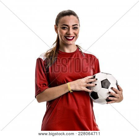Young female fan on red uniform celebrating on white background
