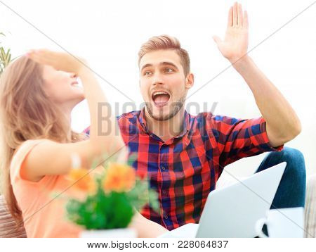happy young couple giving each other a high five