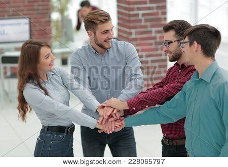 Group of people hands together partnership teamwork.