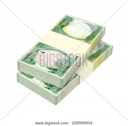Iraqi dinars bills isolated on white with clipping path. 3D illustration.