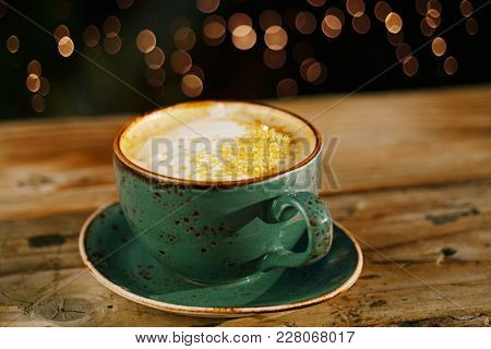 Turmeric latte or golden milk , The drink is made by steaming milk with aromatic turmeric powder and spices