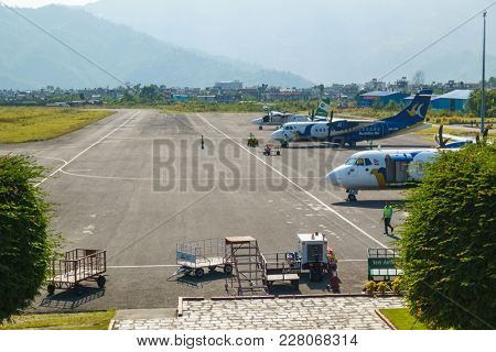 POKHARA, NEPAL - CIRCA NOVEMBER 2017: Three airplanes at Pokhara airport. Pokhara airport is a domestic airport.