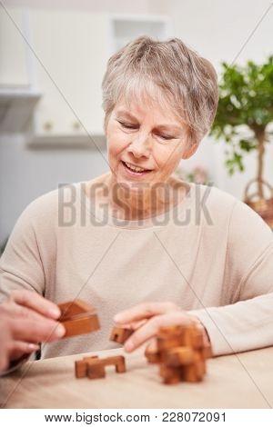 senior woman with dementia building blocks for memory training