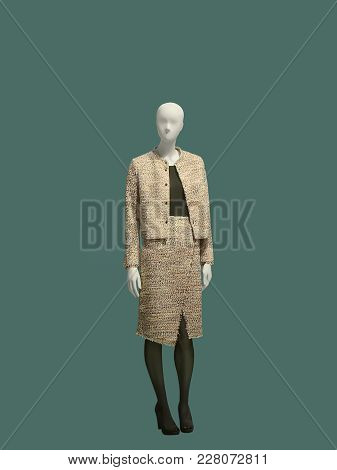 Full-length Female Mannequin Dressed In Fashionable Clothes, Isolated On Green Background. No Brand