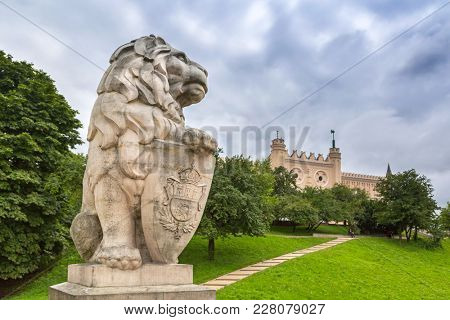 Royal castle in Lublin with guarding lion scrupture, Poland