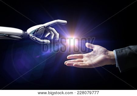 artificial intelligence, future technology and business concept - robot and human hand with flash light over black background