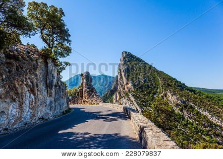 Dangerous and picturesque mountain road in the French Alps, Provence. The fascinating journey to the canyon in Europe - Verdon. Concept of ecological, extreme and active tourism