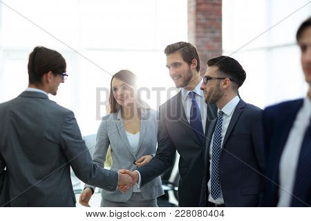 Business people shaking hands in the meeting room