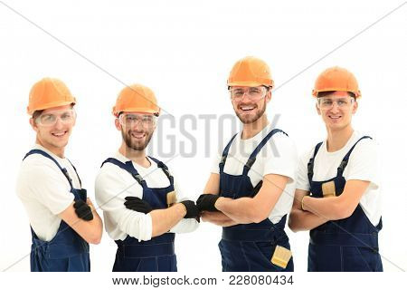 smiling team of construction workers .